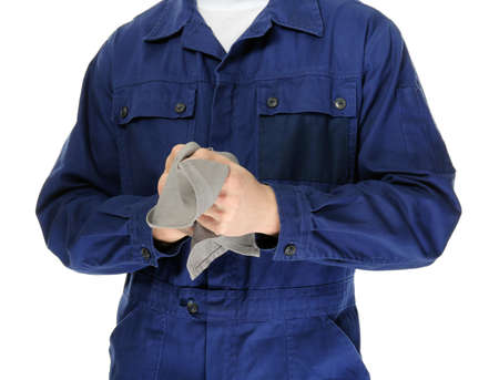 Auto mechanic in uniform on white background, closeup