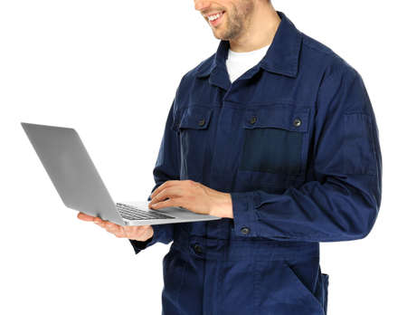 Auto mechanic with laptop on white background