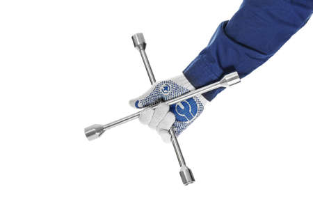 Hand of auto mechanic with wheel wrench on white background Stock Photo