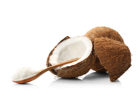 Composition with coconut butter in wooden spoon and nut on white background Stock Photo