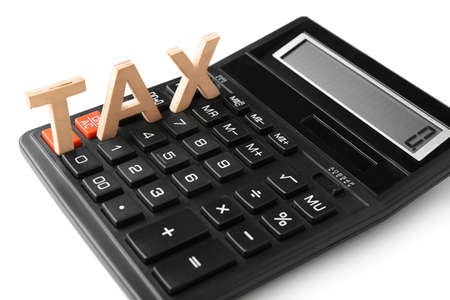 Word TAX and calculator on white background, closeup