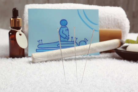 Acupuncture needles and blurred supplies on background 版權商用圖片