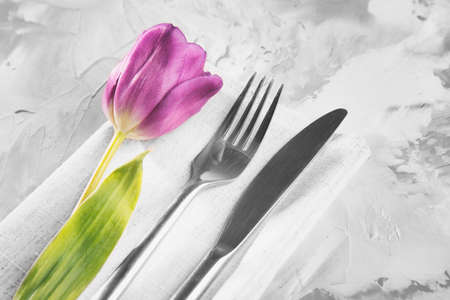 Cutlery set with beautiful flower on grunge background