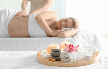 Beautiful spa composition and blurred pregnant woman on background