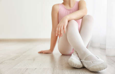 Cute little girl sitting at dance class