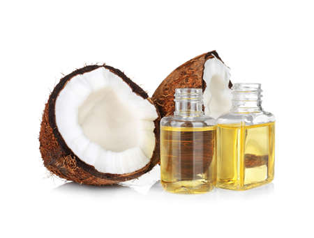 Perfume bottles and coconut on white background