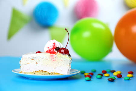 Piece of delicious cheesecake on festive background