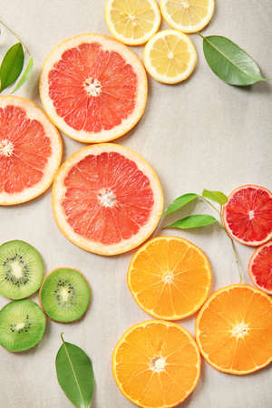 Citrus slices on light background