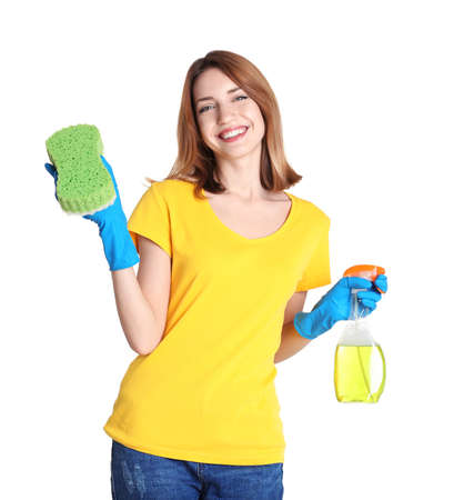 Beautiful young woman holding sponge and cleanser spray on white background Stock Photo
