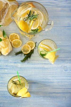 Fresh lemonade and fruits on table Stock Photo