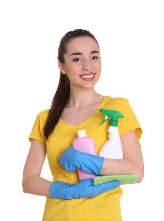 Beautiful young woman holding cleaning supplies for window on white background Stock Photo