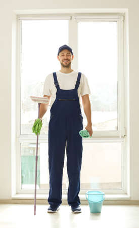 Handsome young window cleaner in office Stock Photo