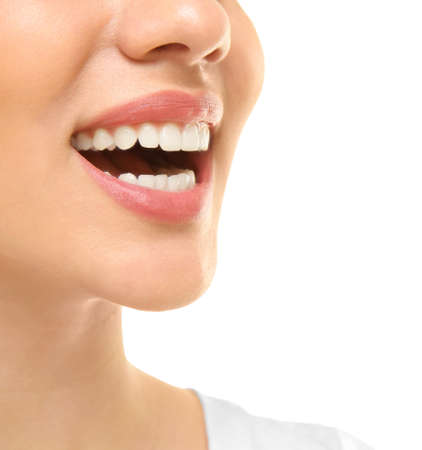 Young beautiful woman smiling on white background. Oral hygiene concept Imagens