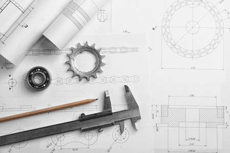 Different kinds of engineering tools on construction drawings background Stock Photo