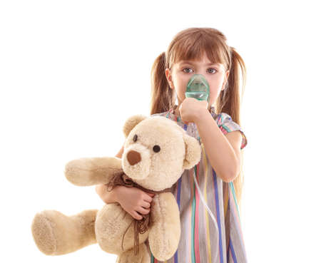 Cute little girl using nebulizer on white background. Allergy concept Stock Photo