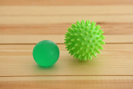 Two rubber balls on light wooden background Stock Photo