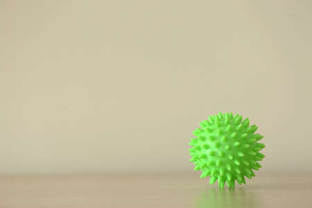 Rubber ball on light background. Concept of physiotherapy Stock Photo
