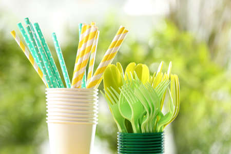 Plastic ware on table outdoors Stock Photo