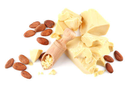 Wooden scoop and pieces of cocoa butter on white background
