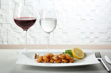 Plate with delicious coconut shrimps on table