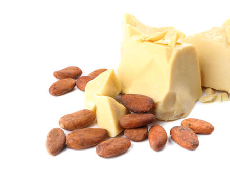 Pieces of cocoa butter and beans on white background