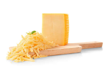 Wooden board with grated cheese and piece on white background