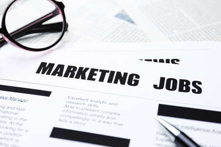 Paper sheet with text MARKETING JOBS, closeup Stockfoto