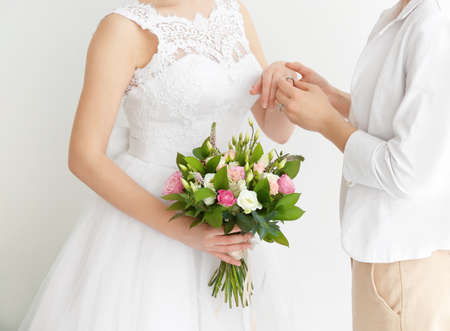 Gay wedding concept. Happy married lesbian couple on light background, closeup Stock Photo
