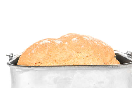 Baking pan with fresh homemade bread on white background, closeup Stock Photo