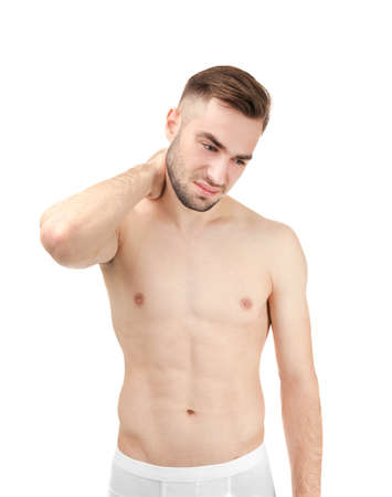 Young man suffering from neck pain on white background Stock Photo