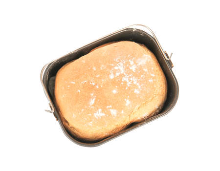 Baking pan with fresh homemade bread on white background