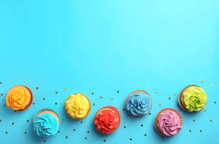 Delicious birthday cupcakes on color background Stock Photo