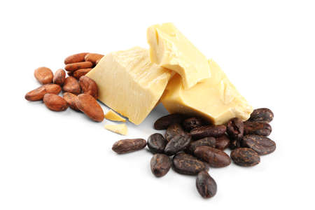 Cocoa butter and beans on white background