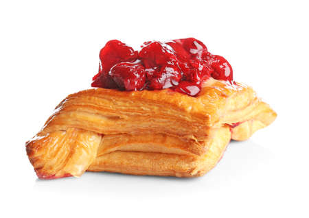 Puff pastry with cherry on white background