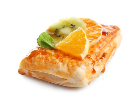 Delicious puff pastry with fruits on white background Imagens