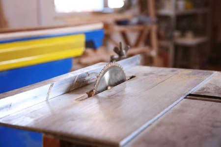 Circular saw in carpenters workshop