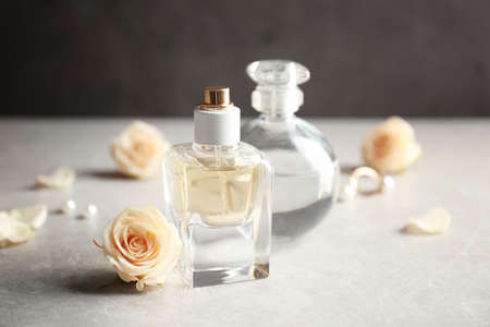 Perfume bottles on grey background Stock Photo
