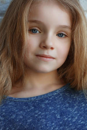 Portrait of cute little girl with long hair
