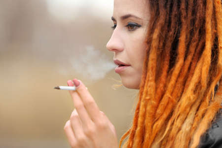 Young beautiful woman smoking weed, closeup