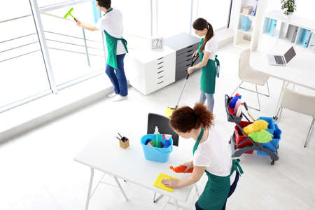 Service team cleaning office
