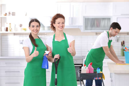 Cleaning service team working in kitchen