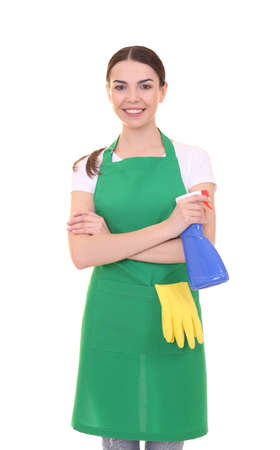 Young woman in green apron on white background. Cleaning service concept Stock Photo