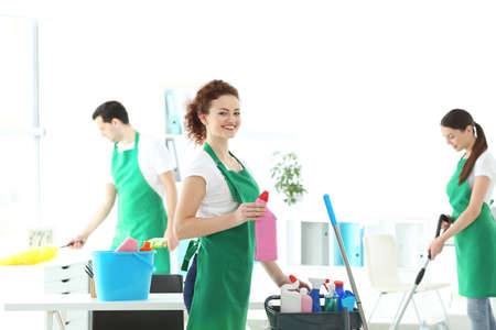 Service team cleaning modern office Stock Photo