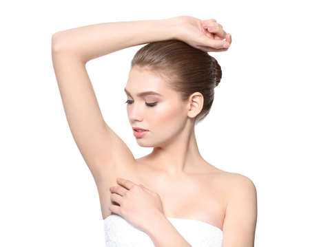Beautiful young woman on white background. Epilation concept Stock Photo