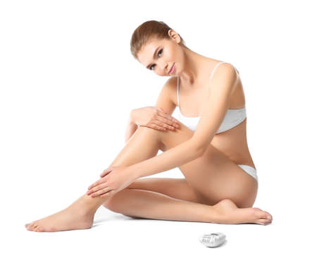 Beautiful young woman with epilator on white background