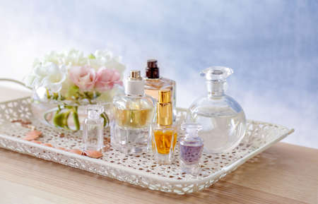Tray with bottles of perfume on table