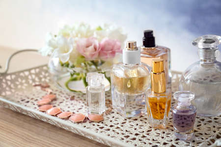 Tray with bottles of perfume on table Stock Photo