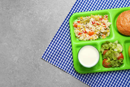 Serving tray with delicious food on table. Concept of school lunch