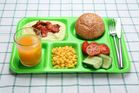 Serving tray with delicious food on tablecloth. Concept of school lunch Zdjęcie Seryjne - 97869267