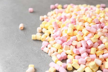 Colorful mini marshmallows on table